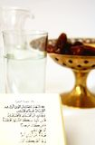 Koran with water and dates Royalty Free Stock Photo