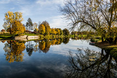 Korana river. River Korana in Karlovac, Croatia. You can see the beautiful autumn colors, yellow and green, the day was extremely sunny and the sky was blue royalty free stock images