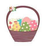 Korb Browns Ostern mit bunten gemalten Eiern stock abbildung