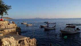 Korcula away. Boats on blue sea, nice sunny day Royalty Free Stock Photos