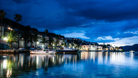 Korcula city in Croatia. Korcula city during blue hour, with boats on blue sea Royalty Free Stock Photos
