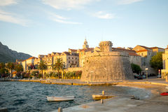 Korcula City - West side. Sunset scene in the old town (west side), with the walls, houses, boats, in Korcula, Croatia Stock Photo