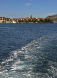 Korcula - Croatia. Unusual view from the boat at Adriatic sea, droplets, foam and beautiful old fortified town of Korcula in Croatia at sunny day - Dalmatia Stock Photography