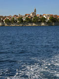 Korcula - Croatia 1. View from the Adriatic sea (track ship sailing on the sea) droplets, foam and beautiful old fortified town of Korcula in Croatia - Dalmatia Stock Photo