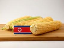 Koreańczyk Z Korei Północnej flaga na drewnianym panelu z kukurudzą odizolowywającą na whit Fotografia Stock