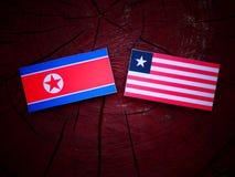 Koreańczyk Z Korei Północnej flaga z liberyjczyk flaga na drzewnym fiszorku odizolowywającym Obraz Royalty Free