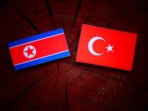 Koreańczyk Z Korei Północnej flaga z turecczyzny flaga na drzewnym fiszorku Zdjęcia Royalty Free