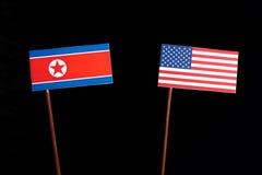 Koreańczyk Z Korei Północnej flaga z usa flaga na czerni Fotografia Royalty Free