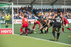 Korea beats New Zealand during the Hockey World Cup 2014. THE HAGUE, NETHERLANDS - JUNE 2: New Zealander Grant is trying to score a goal on the Korean side of stock photo