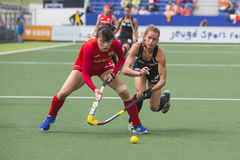 Korea beats New Zealand during the Hockey World Cup 2014. THE HAGUE, NETHERLANDS - JUNE 2: New Zealander Webster is trying to take the ball from Korean Lee stock photos
