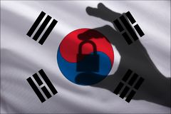 Korea closed lock in the hand. Import and export of goods from the world market of trade is prohibited. Closed borders royalty free stock image
