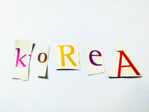 Korea - Cutout Words Collage Of Mixed Magazine Letters with White Background. Caption composed with letters torn from magazines with White Background Royalty Free Stock Images