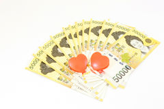 Korea money with twin heart on white background Stock Photo