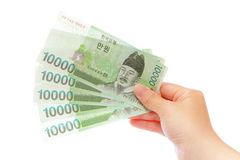 Korea money won and hand Stock Photography