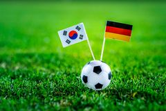 Korea Republic, South Korea - Germany, Group F, Wednesday, 27. June, Football, World Cup, Russia 2018, National Flags on green gra. Ss, white football ball on royalty free stock photo