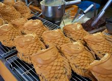 Korea`s delicious and chewy fish-shaped bun filled with red bean paste. Korea`s delicious and chewy fish-shaped bun, filled with red bean paste, lined up side stock photography