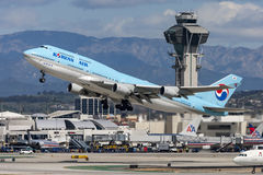 Korean Air Boeing 747 jumbo jet taking off from Los Angeles International Airport. Stock Photo