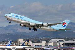 Korean Air Boeing 747 jumbo jet taking off from Los Angeles International Airport. Royalty Free Stock Photo