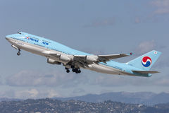 Korean Air Boeing 747 jumbo jet taking off from Los Angeles International Airport. Stock Photos