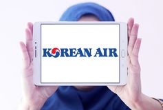 Korean Air logo. Logo of Korean Air on samsung tablet holded by arab muslim woman. Korean Air, is the largest airline and flag carrier of South Korea stock image