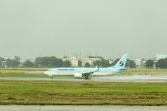 Korean Air take off at Ho Chi Minh airport in Vietnam. Korean Air Lines operating as Korean Air, is the largest airline and flag carrier of South Korea based on Stock Photography