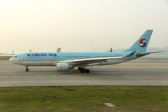 Korean Air take off at Hong Kong airport tarmac. Korean Air Lines operating as Korean Air, is the largest airline and flag carrier of South Korea based on fleet Royalty Free Stock Photography