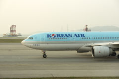 Korean Air take off at Hong Kong airport tarmac. Korean Air Lines operating as Korean Air, is the largest airline and flag carrier of South Korea based on fleet Stock Images