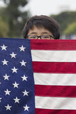 Korean American Boyscout and US Flag at 2014 Memorial Day Event, Los Angeles National Cemetery, California, USA Royalty Free Stock Photography