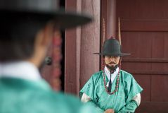 Korean ancient warriors. At the gate with focus on one warrior Royalty Free Stock Image