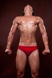 Korean athlet. Young korean bodybuilder posing in studio royalty free stock photography