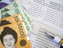 Korean banknote on bank statement Royalty Free Stock Photo