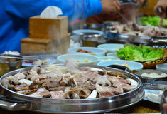 Korean barbecue - meat are being cooked on stove stock photography