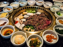 Korean BBQ. With full side dishes stock images