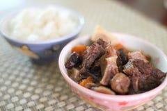 Korean beef stew. Bowl of white rice with Korean beef stew known as kalbi jim Stock Photos