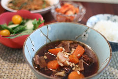 Korean beef stew. Known as kalbi jim with a bowl of white rice and salad Stock Images