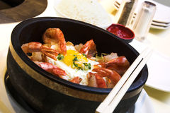 Korean Bibm Bahb. Traditional Korean delicacy made with vegetables and shrimp, served with fried egg and garnished with sesame seeds and chopped green onions Royalty Free Stock Photo