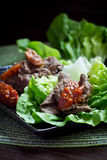 Korean Bulgogi. With ssamjang sauce served with fresh lettuce royalty free stock photography