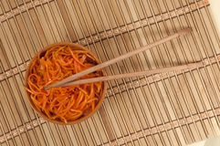 Korean Carrot Salad and chopsticks Stock Photography