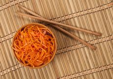 Korean Carrot Salad and two chopsticks Stock Photo