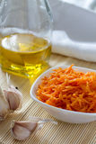Korean carrots with ingredients  for cooking : carrots grated straw, oil, pepper and garlic. Royalty Free Stock Image