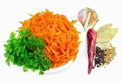 Korean carrots with parsley, pepper, garlic bay leaf, still life Stock Photos