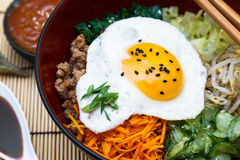 Korean cuisine, beef  Bibimbap in  a clay pot on Stock Photo