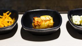 Kimchi appetizer and other banchan side dishes stock photography