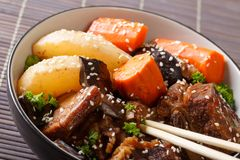 Korean cuisine: ribs stewed with mushrooms, pears and carrots cl royalty free stock image