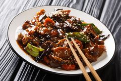 Korean cuisine stir-fried pork with mun mushrooms and vegetables in a thick sauce closeup on a plate. horizontal stock images