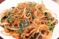 Korean dish known as Japchae. Made from sweet potato noodles, stir fried in sesame oil with various vegetables Stock Photos