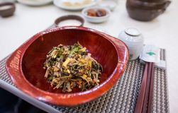 A Korean dish is served on top of a cover. royalty free stock photography