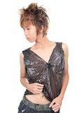 Korean emo teenager fashion pose. Korean punk or emo male teenager in plastic wrapped clothes in a contemplating fashion pose. Isolated over white royalty free stock photography