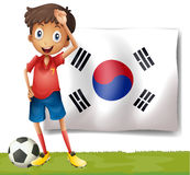 A Korean flag at the back of the soccer player Royalty Free Stock Photos