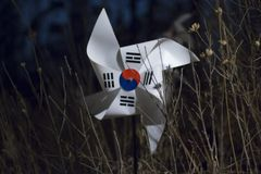 The Korean flag shaped like a pinwheel in the forest at dark night.  royalty free stock photography